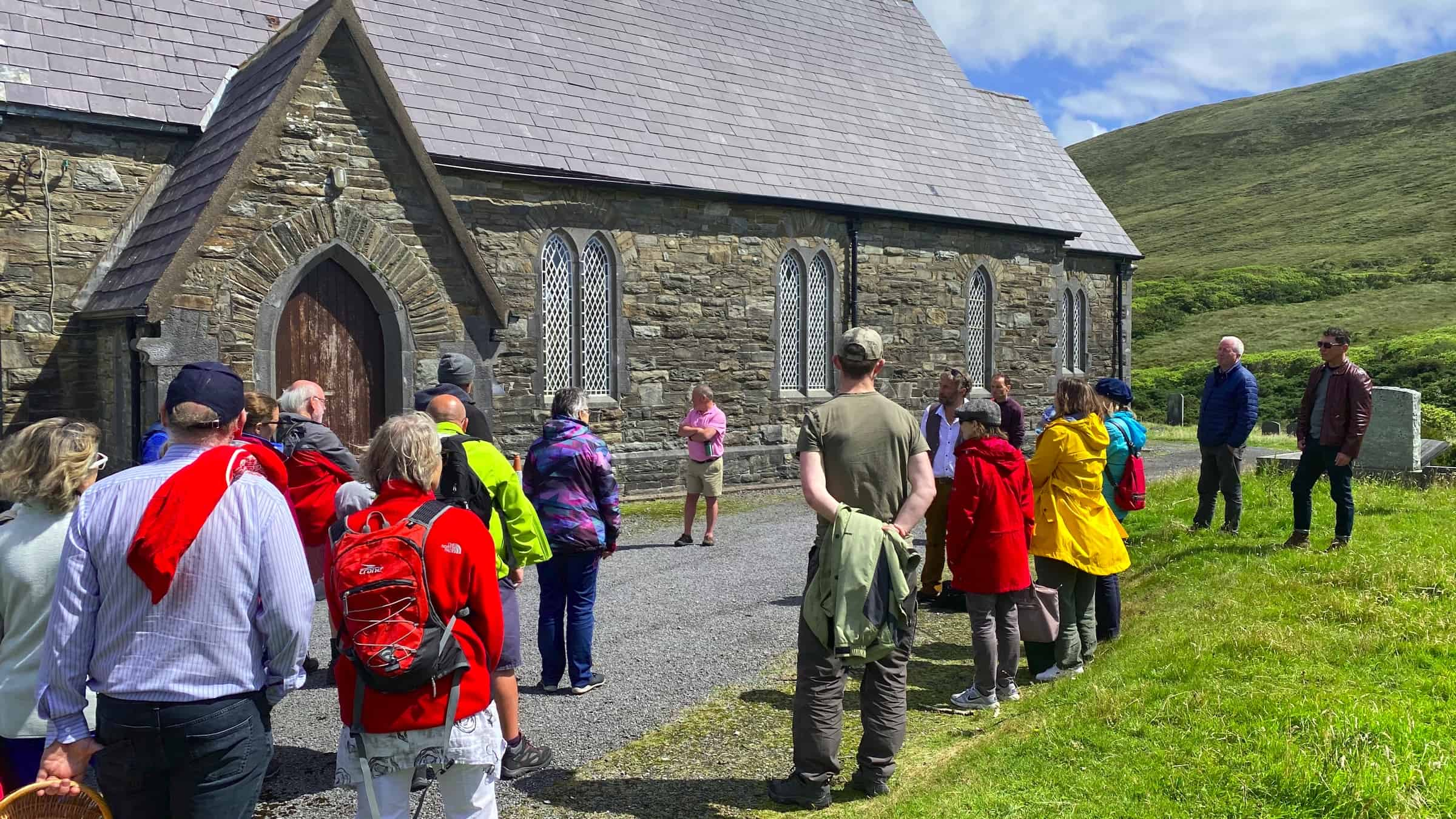 The Colony Tour with Guide Kevin Toolis in waistcoat outside St Thomas' church in Dugort in Achill island Credit photo to Sean Molloy